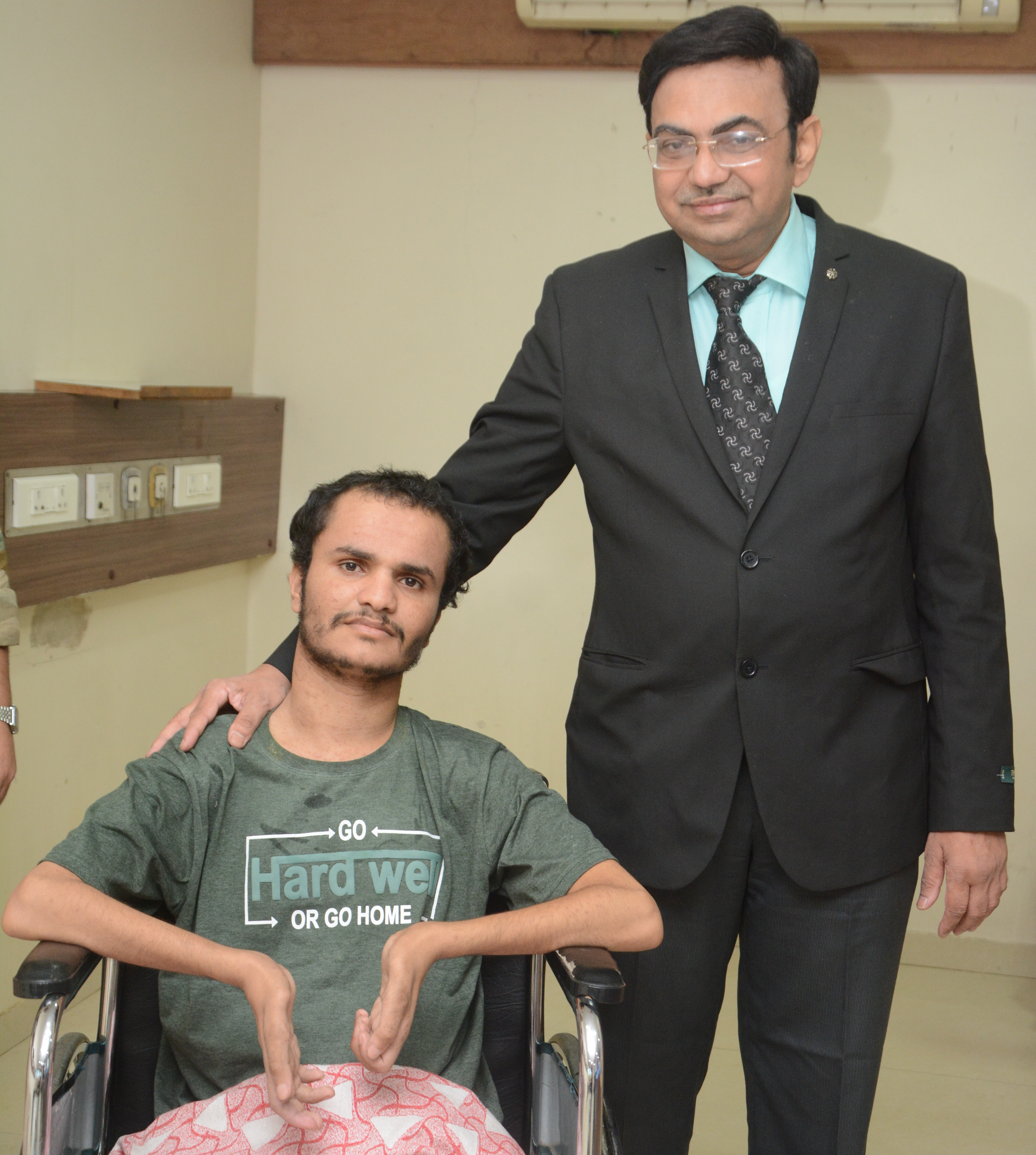 (L-R) Yemen Soldier Mansoor Mohammad Hussaian who was injured due to bullet shot and Orthopeadic Surgeon Dr. Anant Bagul at the Universal Hospital