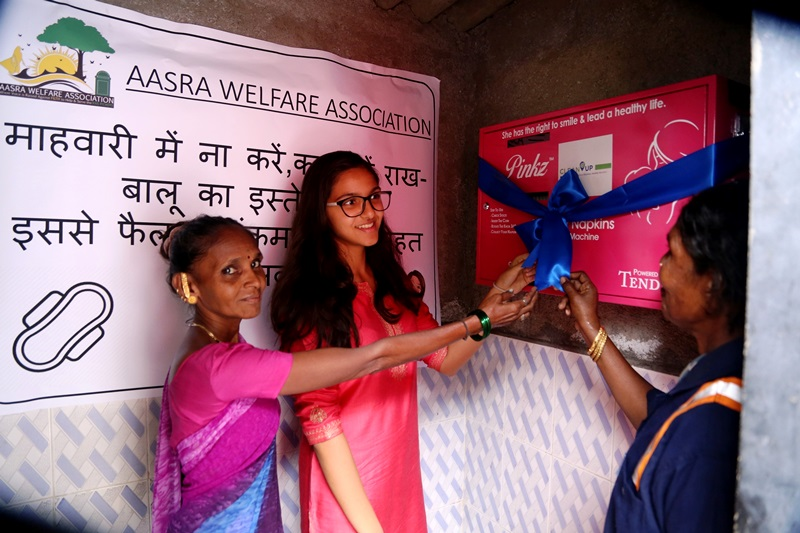 Sanjana Runwal donating the sanitary pad vending machine to women rag-pickers at Bandra